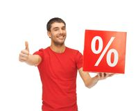 Man with percent sign. Handsome man with percent sign showing thumbs up Stock Photo