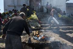 Man performing an ancient Maya ritual in the stairs of the Santo Tomas Church Iglesia de Santo Tomas in the town of Chichicasten stock photos