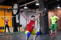 Man performing a barbell snatch at the gym Stock Photography