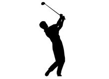 A man performing a golf swing. A silhouette of a man performing a golf swing Royalty Free Stock Photography