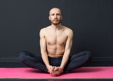 Man  is performing groin muscle stretching Stock Photos