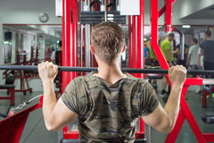 Man performing lat pulldown at the gym Stock Photo
