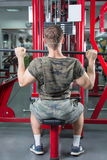 Man performing lat pulldown at the gym Stock Photography