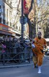 Man Performing Martial Arts - Chinese New Year Parade, Paris 201. Paris, France-February 25,2018: Man performing martial arts with a stick in the street during Stock Photo