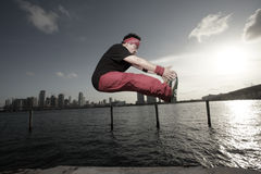 Man performing a midair toe grab. Breakdancer performing a midair toe grab Stock Photography