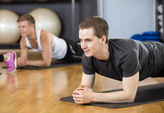 Man Performing Plank Position In Gym Stock Image