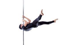 Man performing pole dance. Studio shot, on white background, isolated. Cut Royalty Free Stock Photos