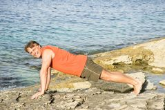 Man performing push ups Stock Photo