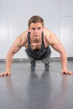 Man performing push ups at the gym Royalty Free Stock Images