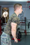 Man performing triceps workout at the gym Stock Images