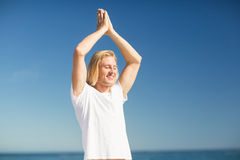 Man performing yoga on beach Royalty Free Stock Photography