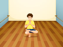 A man performing yoga inside a room Royalty Free Stock Images