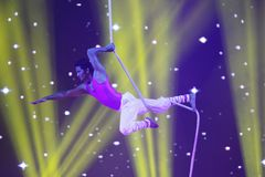 A man performs acrobatic stunt, Mystic India 2013 Royalty Free Stock Photo