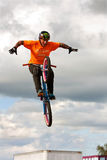 Man Performs Hands Free BMX Stunt At State Fair. Hampton, GA, USA - September 27, 2014:  A young man with the High Roller BMX club takes his hands off the Stock Image