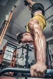 Man performs handstanding at the gym. Photos taken on an atmospheric old gym Royalty Free Stock Photo