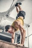 Man performs handstanding at the gym. Photos taken on an atmospheric old gym Royalty Free Stock Photography