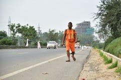 Man perfroming Kanvar Yatra or Kavad Yatra (Hindi Words), it is annual pilgrimage of devotees of  Shiva Stock Photo