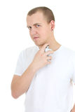 Man with perfume bottle Stock Images