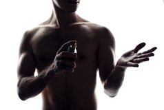 Man with perfume bottle Royalty Free Stock Photography