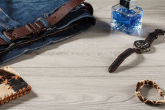Man perfume, watch, leather purse, amulet  and jeans with leathe Stock Photos
