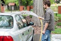 Man perfusing his car Stock Images
