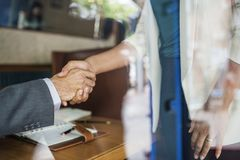 Man and Person Wearing White Suit Jacket Holding Both of Their Hands royalty free stock photo
