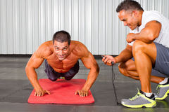 Man and personal trainer Royalty Free Stock Images