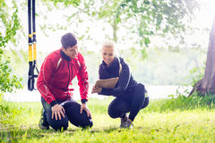 Man with personal trainer at debriefing Royalty Free Stock Photography