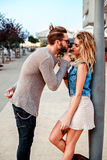 Man persuading a girl to kiss Royalty Free Stock Photography