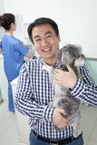 Man with pet dog in veterinarian's office Royalty Free Stock Photo