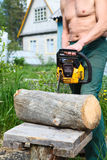 Man with petrol chainsaw Stock Image