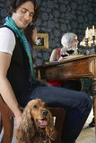 Man Petting Dog At Dinner Party Stock Photos