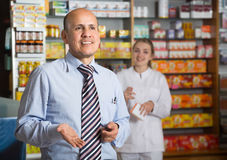 Man pharmacist in apothecary. Smiling men pharmacist in apothecary stock image