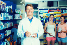 Man pharmacist in drug store Stock Photos
