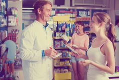 Man pharmacist in pharmaceutical shop Stock Photos