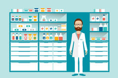 Man pharmacist in a pharmacy, drugstore. Shelves with medicines, cure, pills. Stock Photo