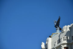 Man on a phoenix. A statue of a man jumping from a phoenix on top of a building Stock Photography