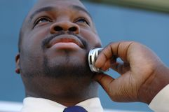 Man on the phone. Young businessman making deals on the phone Royalty Free Stock Photos