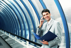 Man with phone. In business style royalty free stock photo