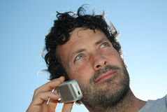 Man and Phone. A man talks on his cell phone royalty free stock image