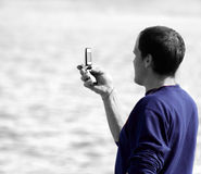Man with Phone. Man holding handphone in black and white royalty free stock image