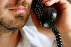 Man on the phone. Young man on the phone royalty free stock images