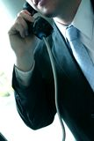 Man on Phone. Business Man talking on the pay telephone Stock Photos