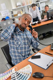 Man on phone with aching back. Man on the phone with aching back stock image