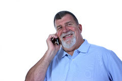 Man on Phone with Big Smile. A smiling man talks on a cell phone Royalty Free Stock Images