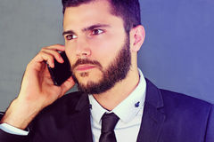 Man with a phone. Businessman passing a phone call stock image