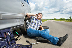 Man with phone is calling in service of car Stock Images