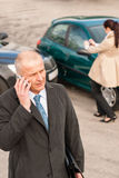 Man on the phone after colliding car Royalty Free Stock Images