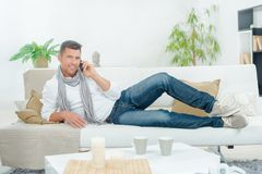 Man on phone on couch. Man on the phone on a couch Stock Photography
