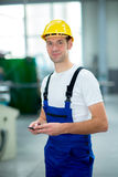 Man with phone in factory Stock Photography